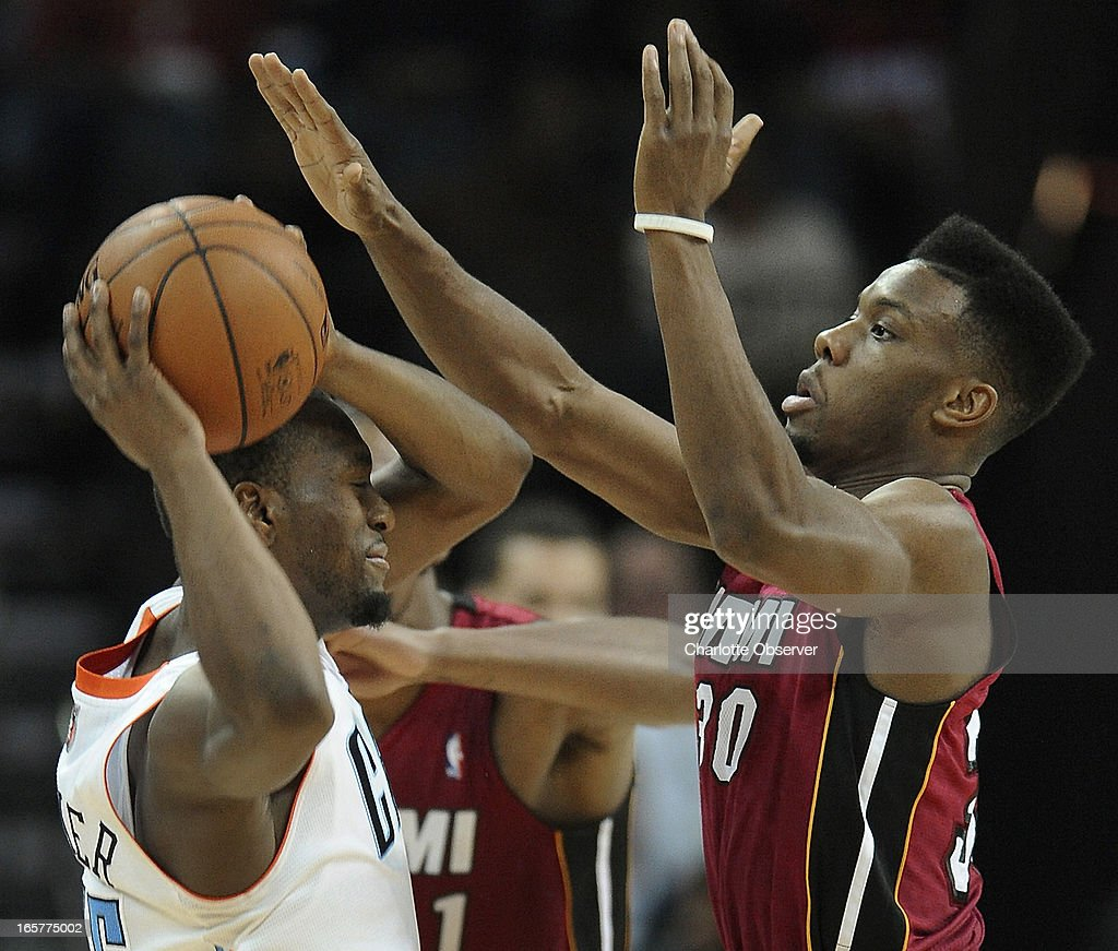 The Charlotte Bobcats' Kemba Walker fights to maintain control of the ball as the Miami Heat's Norris Cole, right, defends during second-half action on Friday, April 5, 2013 at Time Warner Cable Arena in Charlotte, North Carolina. Miami won, 89-79.