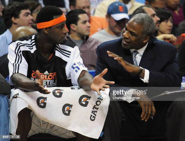 The Charlotte Bobcats' Kwame Brown left and assistant coach Charles Oakley talk after Brown was called for a technical foul following a dunk against...