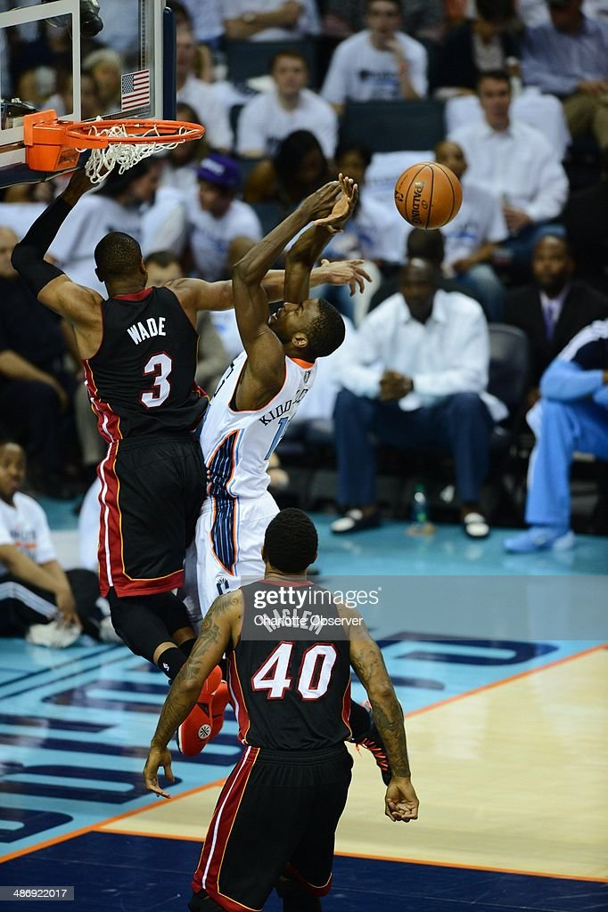 The Charlotte Bobcats' Michael Kidd-Gilchrist goes up for a rebound against the Miami Heat's Dwyane Wade (3) in the first quarter in Game 3 of an Eastern Conference quarterfinal at Time Warner Cable Arena in Charlotte, N.C., on Saturday, April 26, 2014.