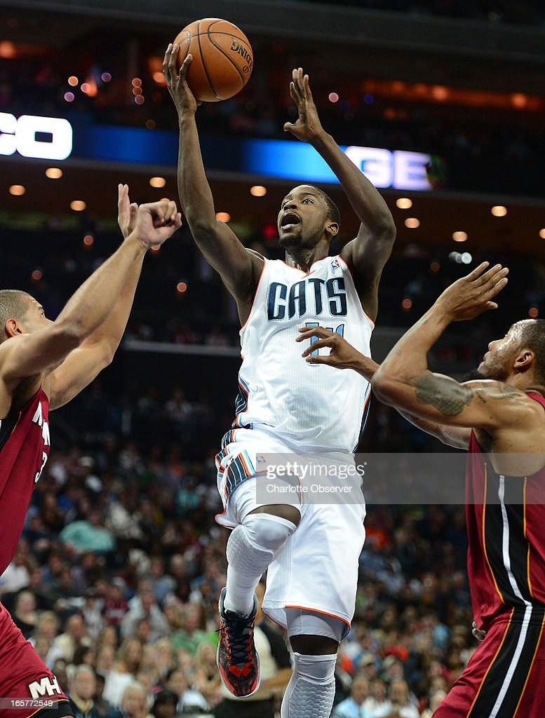 The Charlotte Bobcats' Michael Kidd-Gilchrist splits Miami Heat defenders Shane Battier, left, and Joel Anthony during first-half action on Friday, April 5, 2013 at Time Warner Cable Arena in Charlotte, North Carolina.