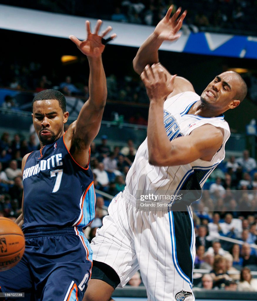 The Charlotte Bobcats' Ramon Sessions (7) knocks the ball away from the Orlando Magic's Arron Afflalo, right, at the Amway Center in Orlando, Florida, on Friday, January 18, 2013. Charlotte won, 106-100.