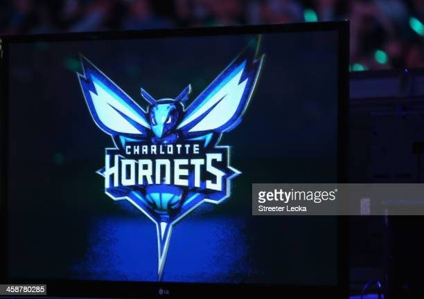 The Charlotte Bobcats unveil the new logo for next years team name change during their game at Time Warner Cable Arena on December 21 2013 in...