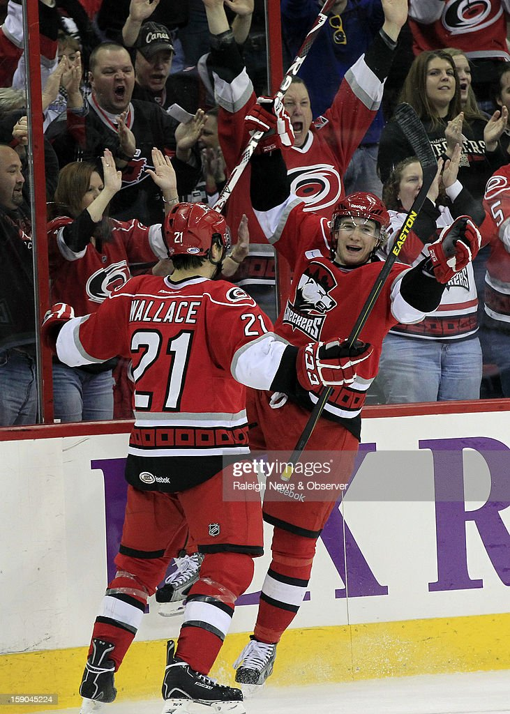 The Charlotte Checkers' Zac Dalpe (19) celebrates his goal with teammate Tim Wallace (21) during the second period as they play the Norfolk Admirals in an American Hockey League game at the PNC Arena on Sunday, January 6, 2013, in Raleigh, North Carolina. The Checkers are the Carolina Hurricanes highest-level minor league franchise. The NHL announced an agreement with the players union on the lockout Sunday.