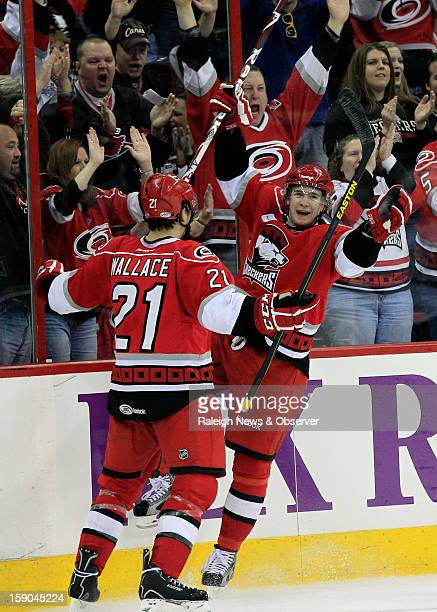 The Charlotte Checkers' Zac Dalpe celebrates his goal with teammate Tim Wallace during the second period as they play the Norfolk Admirals in an...