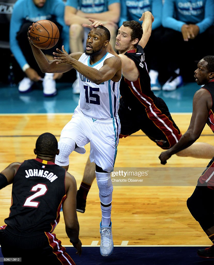 The Charlotte Hornets' Kemba Walker (15) drives to the basket for two-points as the Miami Heat's Goran Dragic defends during Game 6 of the Eastern Conference quarterfinals on Friday, April 29, 2016, at Time Warner Cable Arena in Charlotte, N.C.
