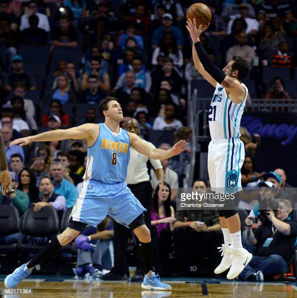 The Charlotte Hornets' Marco Belinelli right drains a 3point basket over the Denver Nuggets' Danilo Gallinari in the second half on Friday March 31...