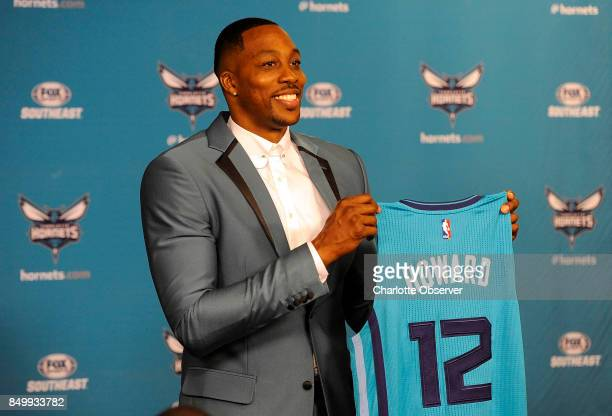 The Charlotte Hornets' new center Dwight Howard holds up his jersey during a news conference on June 26 at the Spectrum Center in Charlotte NC