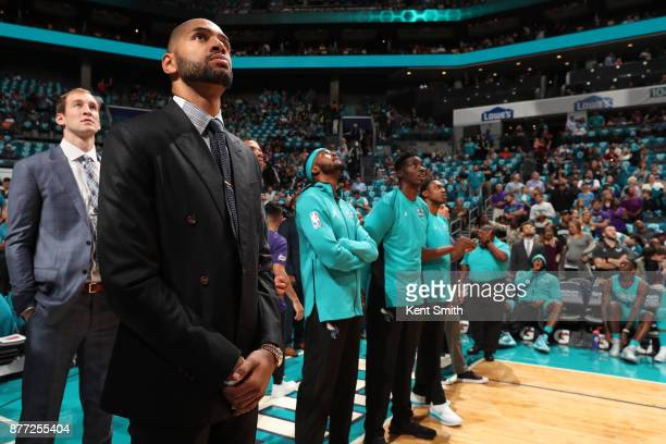 The Charlotte Hornets stands for the National Anthem before the game against the Atlanta Hawks on October 20 2017 at Spectrum Center in Charlotte...