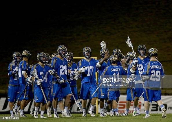 The Charlotte Hounds celebrate after defeating the Denver Outlaws during their game at American Legion Memorial Stadium on June 27 2015 in Charlotte...