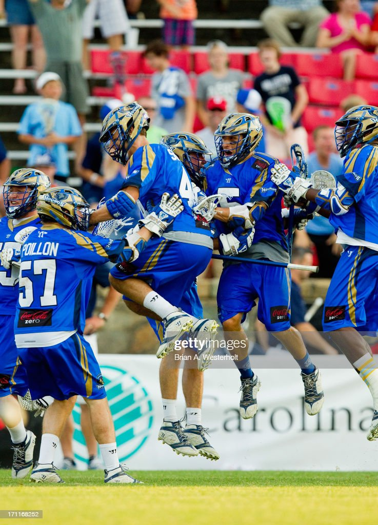The Charlotte Hounds celebrate after Ryan Young #27 (C) scored the game-winning goal in overtime against the Chesapeake Bayhawks at American Legion Memorial Stadium on June 22, 2013 in Charlotte, North Carolina. The Hounds defeated the Bayhawks 16-15 in overtime.