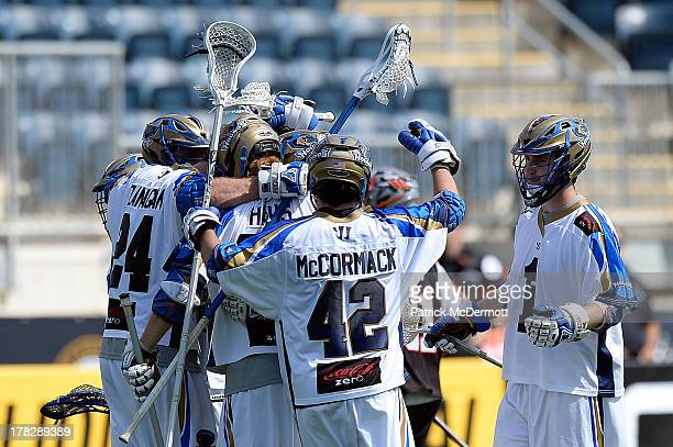 The Charlotte Hounds celebrate after scoring a goal against the Denver Outlaws during the 2013 MLL Semifinal game at PPL Park on August 24 2013 in...