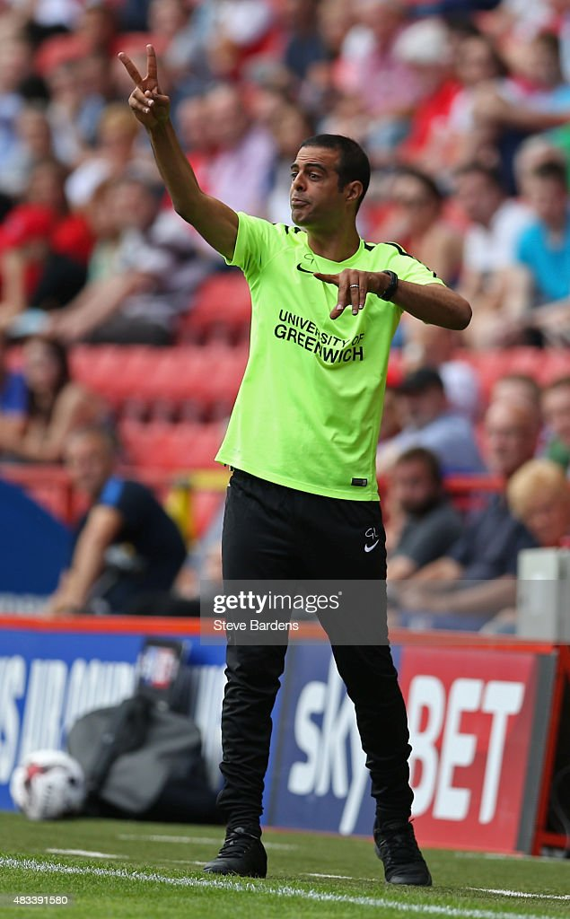 The Charlton Athletic manager <a gi-track='captionPersonalityLinkClicked' href=/galleries/search?phrase=Guy+Luzon&family=editorial&specificpeople=4595259 ng-click='$event.stopPropagation()'>Guy Luzon</a> gives instructions during the Sky Bet Championship match between Charlton Athletic v Queens Park Rangers at The Valley on August 8, 2015 in London, England.