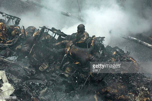 CONTENT The charred bodies of passengers are seen in their seats among the smouldering wreckage of an Air India Boeing 737800 aircraft which crashed...