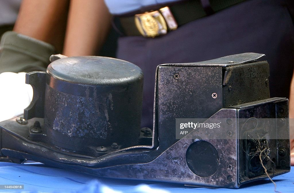 The charred cockpit voice recorder of the Russian Sukhoi Superjet 100 is seen on a table during a turnover ceremony to the Indonesian investigating...