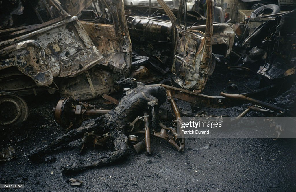 The charred corpse of an Iraqi soldier lies among the rubble after an Iraqi convoy is destroyed by coalition bombing during the Persian Gulf War In...