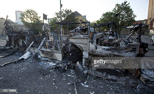 The charred remains of a bus are pictured in Croydon south of London on August 9 following a third night of violence on the streets of London...
