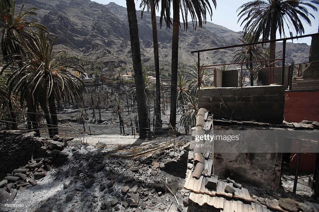 The charred remains of a home are seen on August 14, 2012 in Valle Gran Rey after wildfires devastated the Spanish Canary island of La Gomera. The blaze on the Atlantic island of La Gomera which broke out more than a week ago has forced 5,000 people to be evacuated and ravaged more than 4,000 hectares (10,000 acres) of land, including part of a rare nature reserve. AFP PHOTO / DESIREE MARTIN