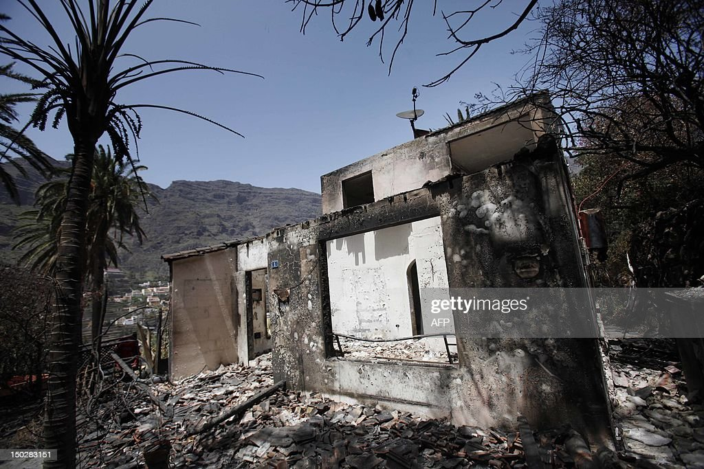 The charred remains of a home are seen on August 14, 2012 in Valle Gran Rey after wildfires devastated the Spanish Canary island of La Gomera. The blaze on the Atlantic island of La Gomera which broke out more than a week ago has forced 5,000 people to be evacuated and ravaged more than 4,000 hectares (10,000 acres) of land, including part of a rare nature reserve.