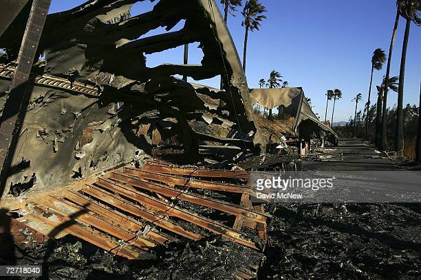 The charred remains of a truck trailer is one of a line of nine burned along a road near the burnedout former Egg City factory which neighbors say...