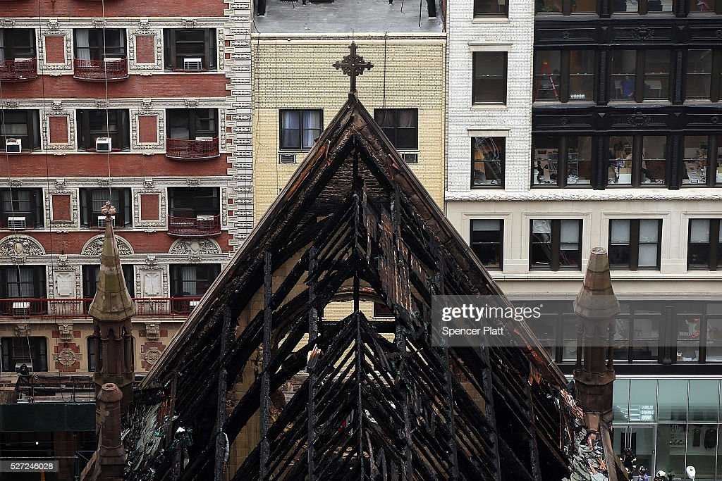 The charred remains of the roof are seen as firefighters continue to work at the scene where the Serbian Orthodox Cathedral of Saint Sava was gutted in a massive fire Sunday evening in the Flatiron District on May 02, 2016 in New York City. The fire, which started on the day which Serbian Orthodox parishioners had celebrated Easter at the church, injured a number of firefighters, none critically. The landmark church was a historic testament to the once vibrant Serbian community in the area.
