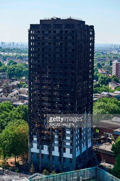 The charred remnains of the Grenfell Tower block is pictured in Kensington west London on June 17 follwing the June 14 fire at the residential...