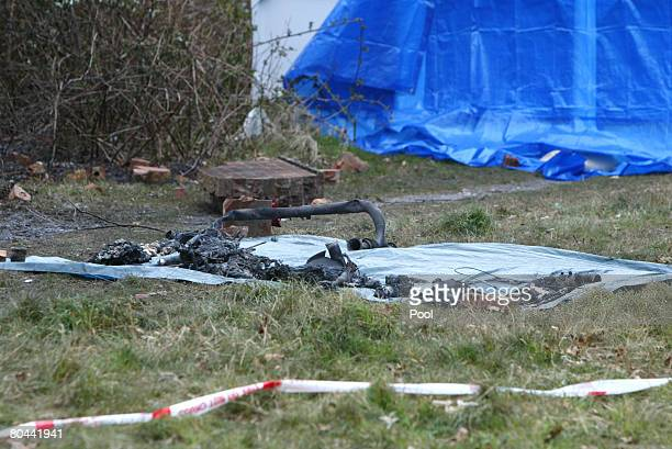 The charred wreckage lays beside a wall after an executive jet crashed on March 31 2008 in Farnborough England Emergency services have begun to...