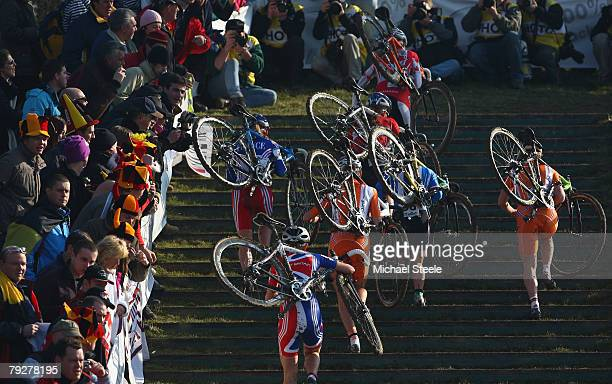 The chasing pack climb steep grassed steps in the women's race during the UCI Cyclo Cross World Championship at Lago Le Bandie on January 27 2008 in...
