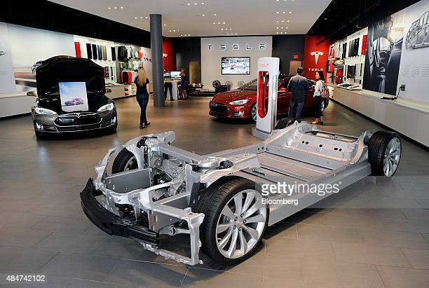 The chassis of a Model S P85D electric vehicle is displayed at the Tesla Motors Inc retail store in San Jose California US on Thursday Aug 20 2015...