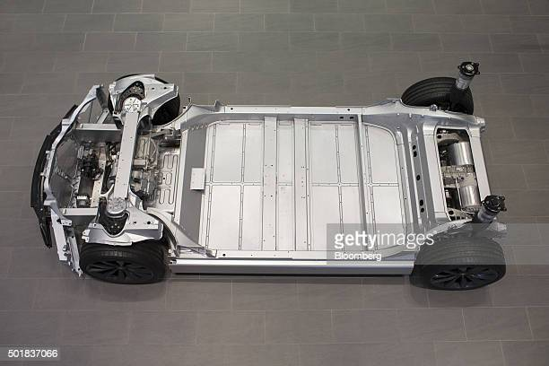 The chassis of a Tesla Model S automobile sits on display inside a Tesla Motors Inc showroom in Paris France on Thursday Dec 17 2015 After losing...