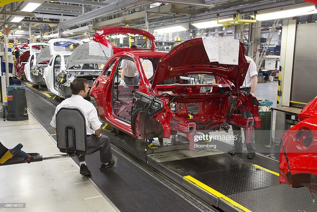 The chassis of Adam Opel AG automobiles move along the production line at the Opel factory, operated by General Motors Co. (GM), in Eisenach, Germany, on Wednesday, April 23, 2014. European sales at Opel and its U.K. sister brand Vauxhall gained 8.5 percent to 226,888 cars in the first quarter, slightly better than the 8.1 percent increase for the market overall, according to ACEA data. Photographer: Martin Leissl/Bloomberg via Getty Images