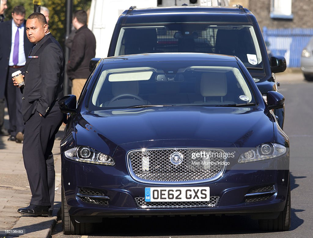 The chauffeur of Prince William, Duke of Cambridge and Catherine, Duchess of Cambridge stands by The Duchess's Jaguar car as she visits to Hope House, a residential treatment centre, on February 19, 2013 in London, England.
