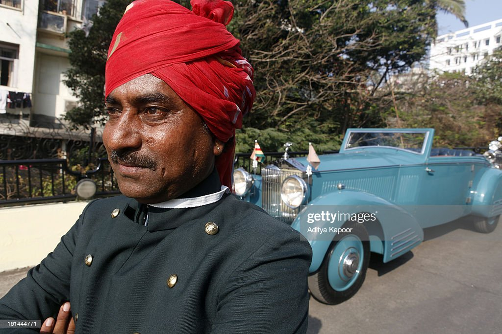 The chauffeur of the 1935 Rolls Royce Phantom II, the winning car of the Cartier 'Travel With Style' Concours 2013 Opening at Taj Lands End on February 10, 2013 in Mumbai, India.