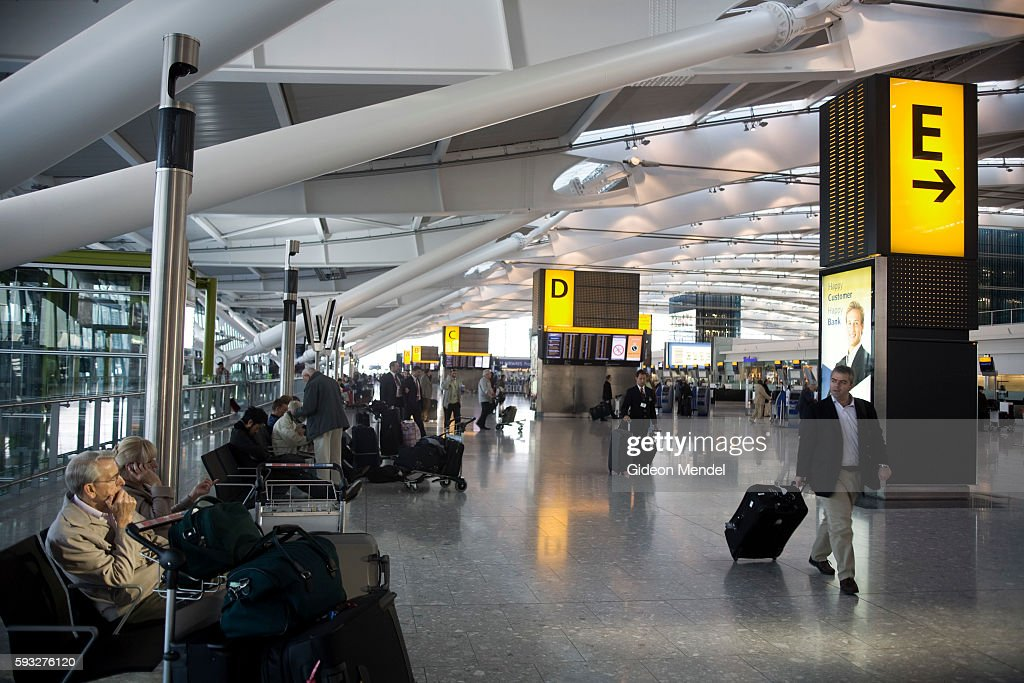 The check in hall at the new Heathrow Terminal 5 building This area has architecturally distinctive white steel truss roof interspersed with bands of...