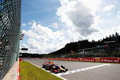 The checkered flag flies as Daniel Ricciardo of Australia and Infiniti Red Bull Racing crosses the finish line to win the Belgian Grand Prix at...