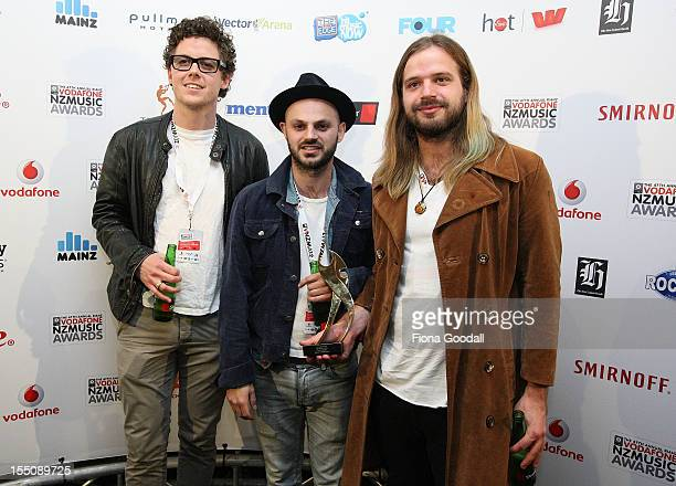 The Checks Callum Martin Karel Chabera and Sven Pettersen poses after winning the best rock album award during the 2012 Vodafone New Zealand Music...