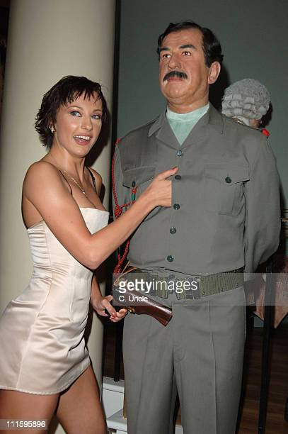 The Cheeky Girls with Saddam Hussein waxwork during Fabulous Gay Weddings Launch Party at Madame Tussauds in London Great Britain