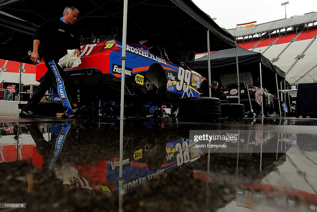 The #99 Cheez-It Ford of Carl Edwards sits under cover as rain falls prior to the NASCAR Sprint Cup Series Food City 500 at Bristol Motor Speedway on March 18, 2012 in Bristol, Tennessee.