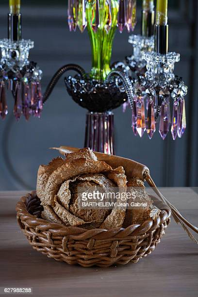 The chef Alain Passard presente the vegetal menu of Christmas the carved bread in the form of cabbage of the Parisian baker Frédéric Pichard on...