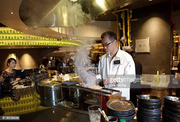 The chef cooks yakitori chicken at the casual dining space Noren in the ISETAN The Japan Store Kuala Lumpur LGF THE MARKET section during the ISETAN...