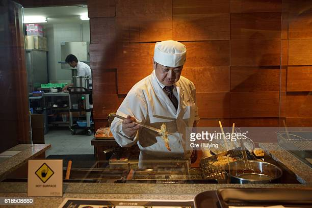 The chef makes a tempura at the casual dining space Noren in the ISETAN The Japan Store Kuala Lumpur LGF THE MARKET section during the ISETAN The...