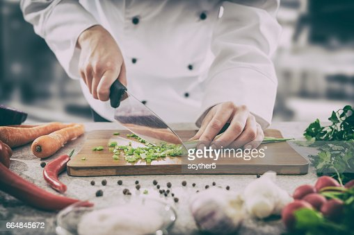 The chef slicing vegetables. : Stock Photo