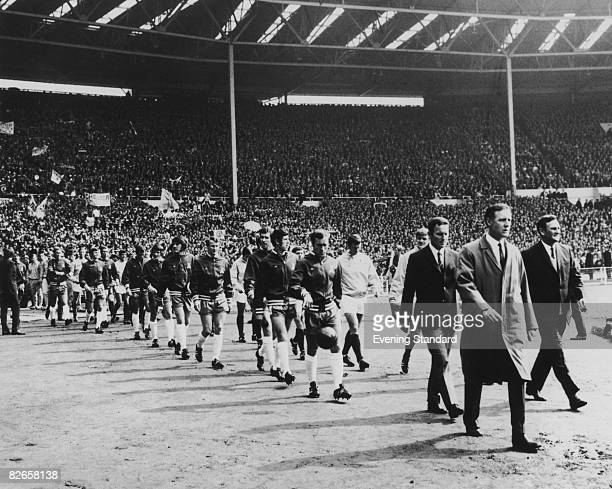 The Chelsea and Leeds United teams walk out before the FA Cup final at the Empire Stadium Wembley London 11th May 1970 The teams drew 22 and Chelsea...
