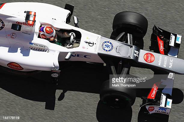 The Chelsea Football Club logo is seen on the car of Kamui Kobayashi of Japan and Sauber F1 as he drives during practice for the Spanish Formula One...