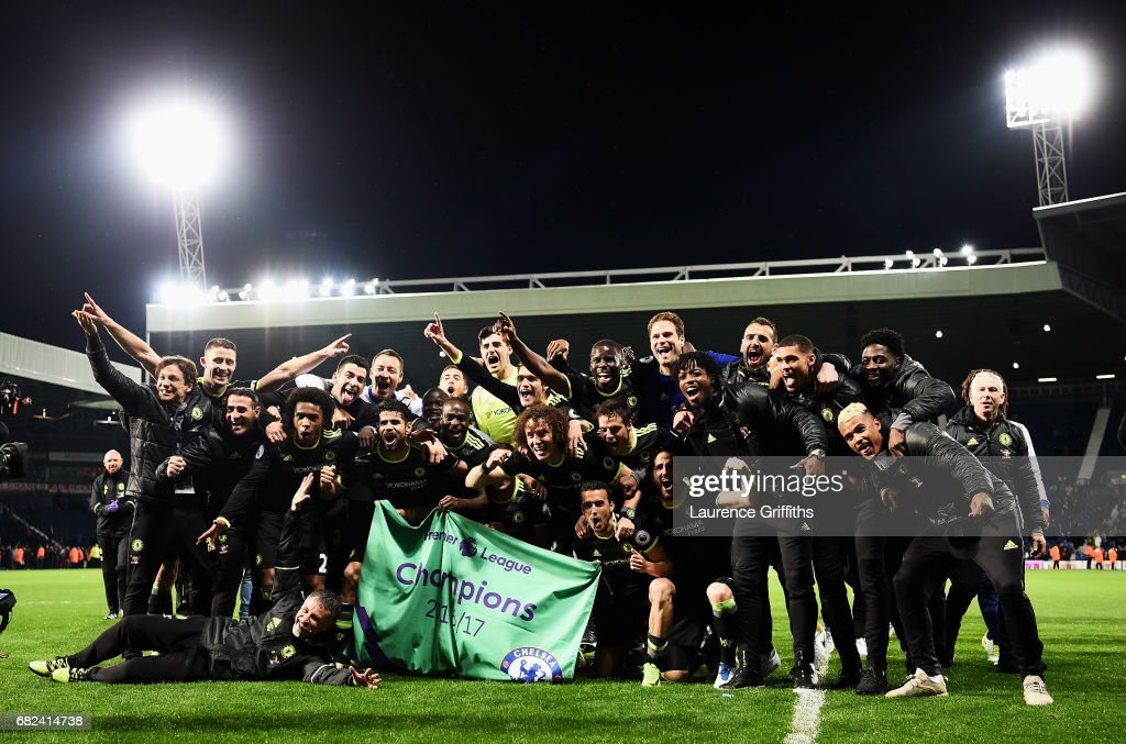 The Chelsea players and staff celebrate winning the leauge after the Premier League match between West Bromwich Albion and Chelsea at The Hawthorns on May 12, 2017 in West Bromwich, England.Chelsea are crowned champions after a 1-0 victory against West Bromwich Albion.