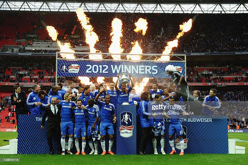 The Chelsea players celebrate with the FA Cup trophy during the FA Cup with Budweiser Final between Liverpool and Chelsea at Wembley Stadium on May 5, 2012 in London, England.