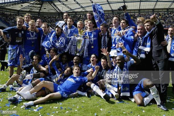 The Chelsea team celebrate after receiving the Barclays Premiership Trophy at Stamford Bridge on May 7 2005 in London England