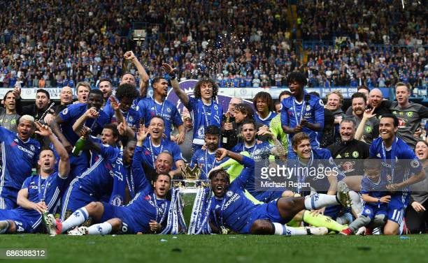 The Chelsea team celebrate with the Preimer League Trophy after the Premier League match between Chelsea and Sunderland at Stamford Bridge on May 21...