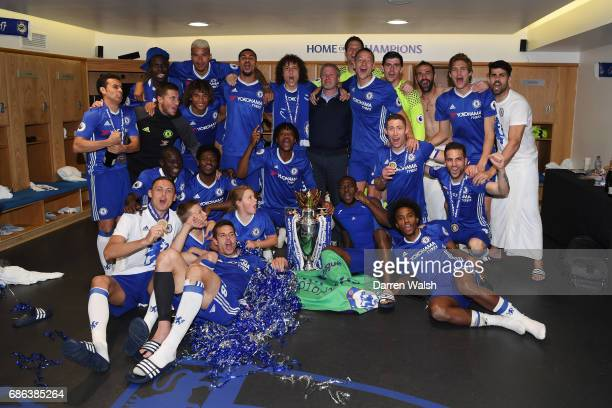 The Chelsea team celebrate with the Premier League Trophy in the changing room after the Premier League match between Chelsea and Sunderland at...