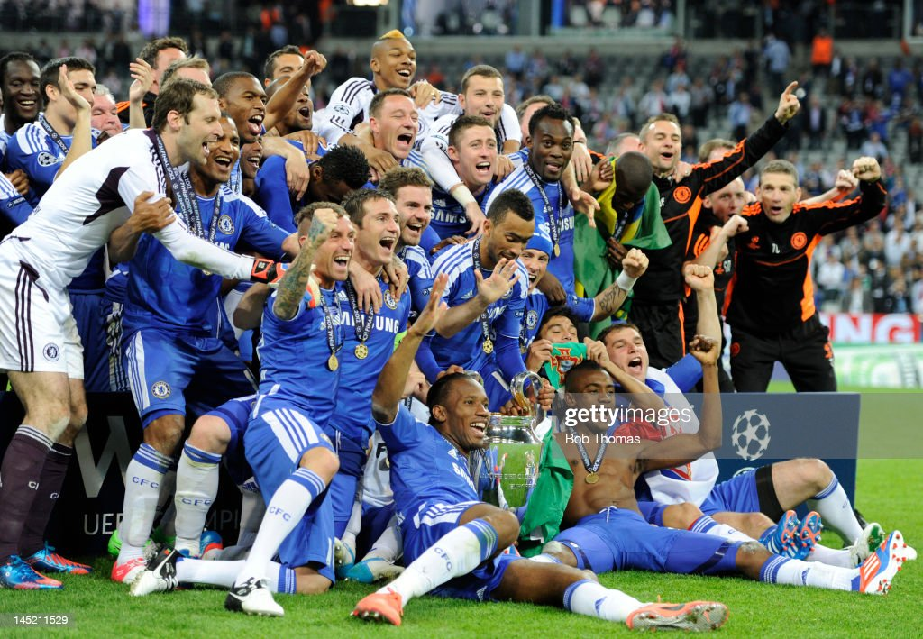 The Chelsea team celebrate with the trophy after the UEFA Champions League Final between FC Bayern Munich and Chelsea at the Fussball Arena Munich on May 19, 2012 in Munich, Germany. Scorer of Chelsea's winning penalty Didier Drogba is in the foreground (orange boots). The match ended 1-1 after extra time, Chelsea won 4-3 on penalties.