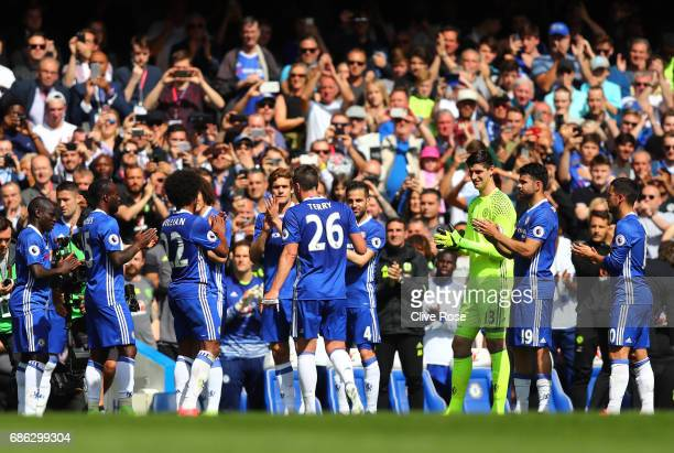 The Chelsea team crerate a guard of honor as John Terry of Chelsea is subbed off during the Premier League match between Chelsea and Sunderland at...